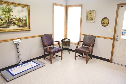 Part of the waiting area and a pet scale